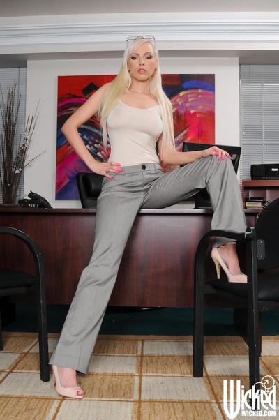 Busty blonde milf Alexis strips in the office and masturbates having stretched the legs widely