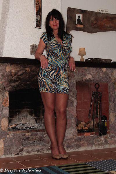 Brunette nylon model Desyra Noir flashing butt cheeks and garters