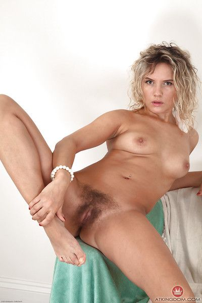Older solo model Regina revealing hairy cunt and ass while undressing