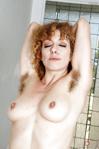 Aged lady Leona baring hairy upskirt vagina and pink labia lips