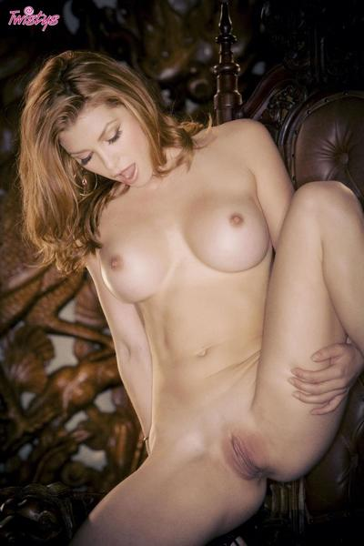 Gorgeous Heather Vandeven hotly poses and strips her black lingerie in a big leather armchair