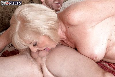 Buxom blonde granny Scarlet Andrews taking cumshot after ball licking bj