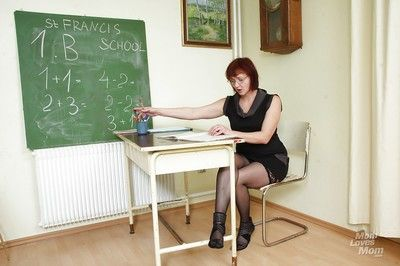 Naughty aged teacher in glasses masturbating her hairy cunt