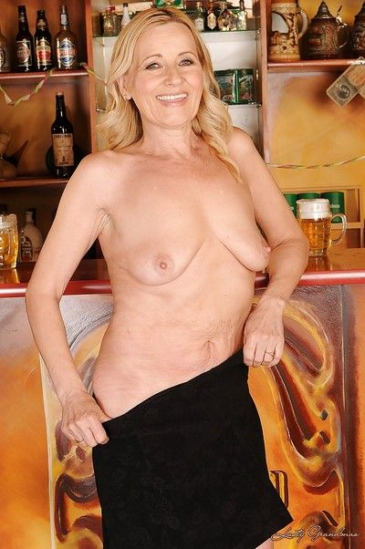 Stunning blonde granny on high heels slipping off her clothes