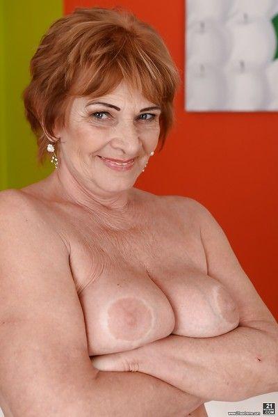 Redheaded Euro granny Sally G modeling lingerie before posing naked