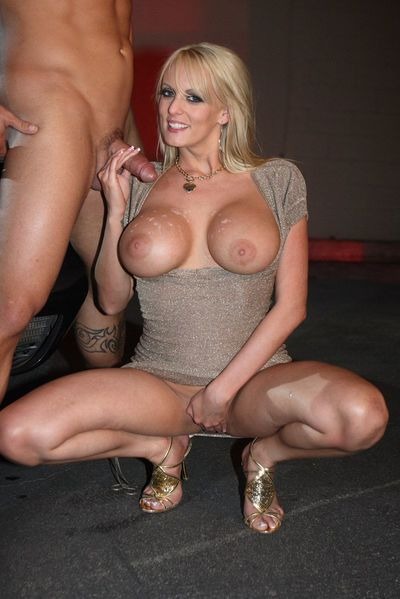 Guy is enjoying the beautiful big melons and smooth skin of busty Stormy Daniels