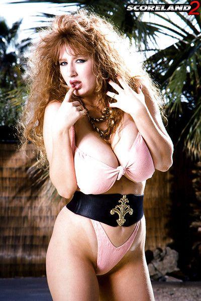 Thick mature woman Jessica Juggs loosing massive tits from bikini by pool