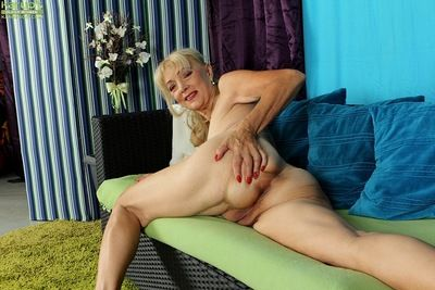 Naughty granny Janet Lesley revealing saggy tits before spreading cooter