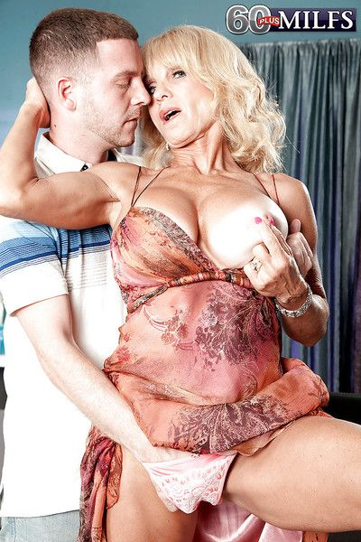 Chesty granny Cara Reid taking hardcore cumshot in mouth from younger man