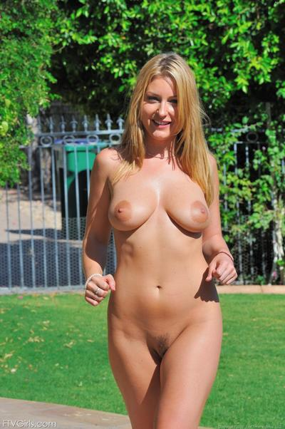 Busty blue-eyed blonde Avy Scott has fun masturbating with vegetables and water hose
