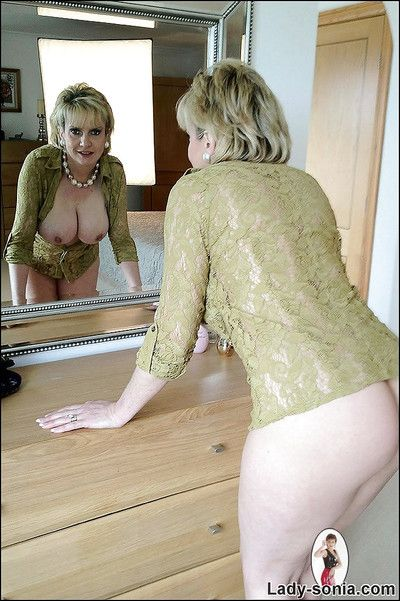Fuckable mature fetish lady with big tits stripping off her clothes