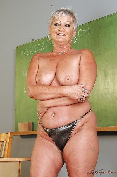 Short haired fatty granny stripping off her dress and lingerie