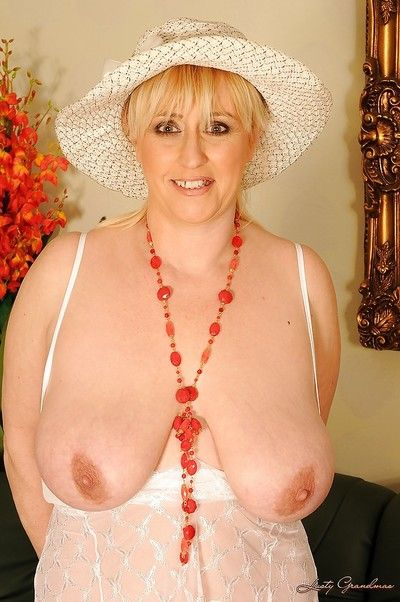 Fatty big titted granny drops her panties to feel her wet pussy