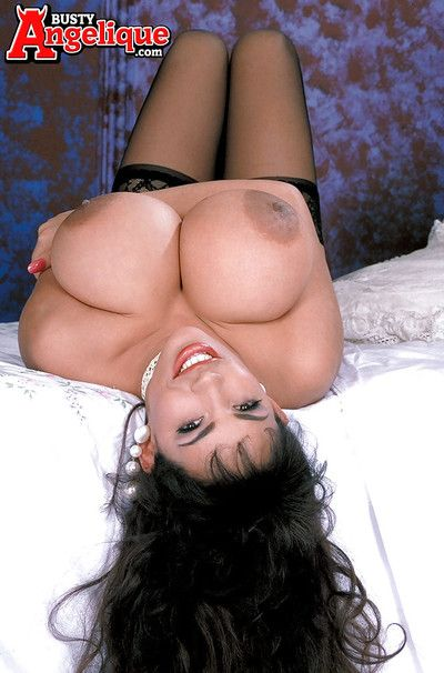 Older Latina pornstar Busty Angelique revealing massive knockers in nylons