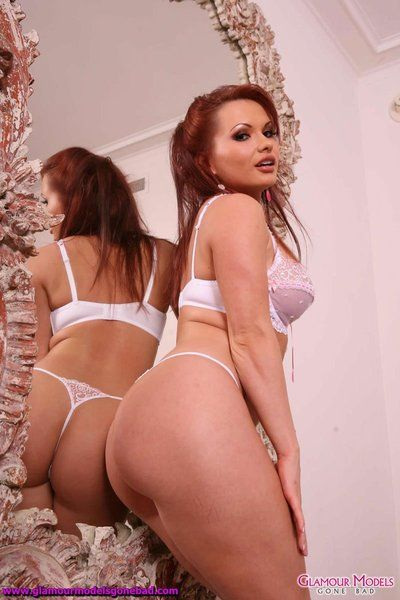 Busty redhead MILF Katja Kassin slips out of her sexy lingerie and plays with herself