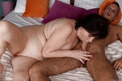 Fat brunette granny Tilda jerking off and sucking cock for cumshot