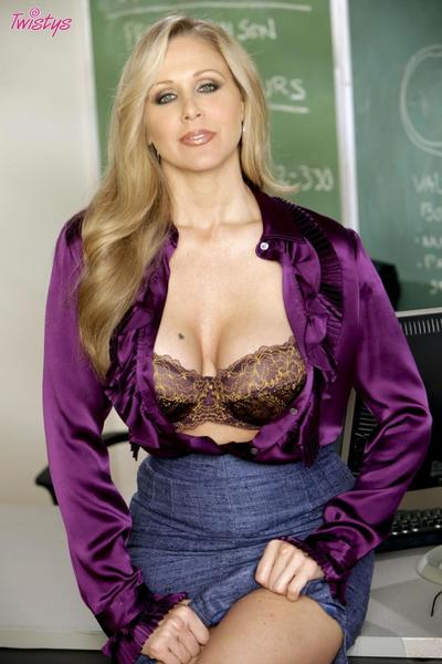 Fine looking big boobed milf teacher Julia Ann strips naked on her desk