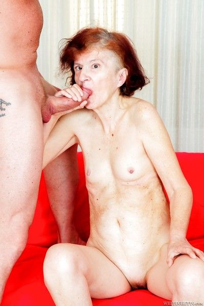 Redhead granny with tiny tits removes glasses before hardcore fucking