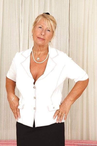 Short-haired blonde granny Regi is demonstrating her gorgeous boobs