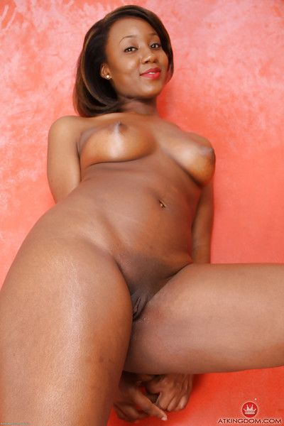 Mature black lady Chiya showing off nice ass while spreading pussy lips