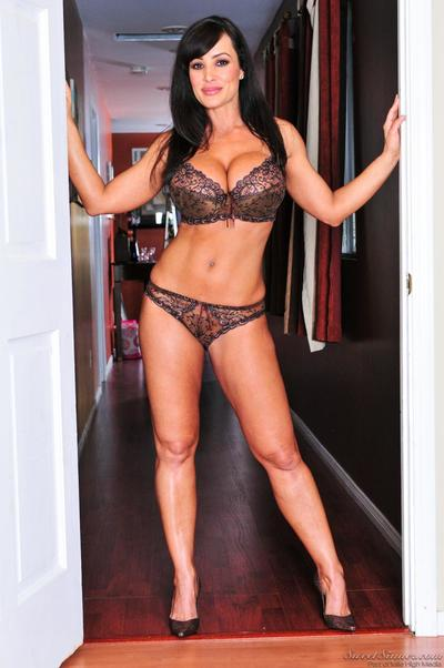 This softcore gallery is all about Lisa Ann in lingerie, as she is posing...