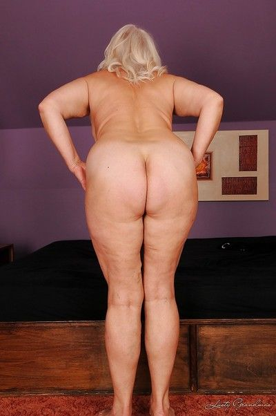 Fatty granny with big flabby jugs stripping and spreading her legs