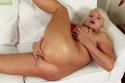 Blonde granny with big tits Iris shows off in her red panties