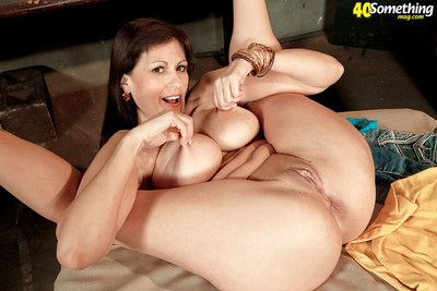 Hot over 40 lady Tori Dean exposing big natural tits in high heels