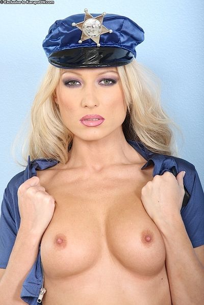 Stunning police woman Sue Diamond in blue uniform and black boots shows her naughty bits