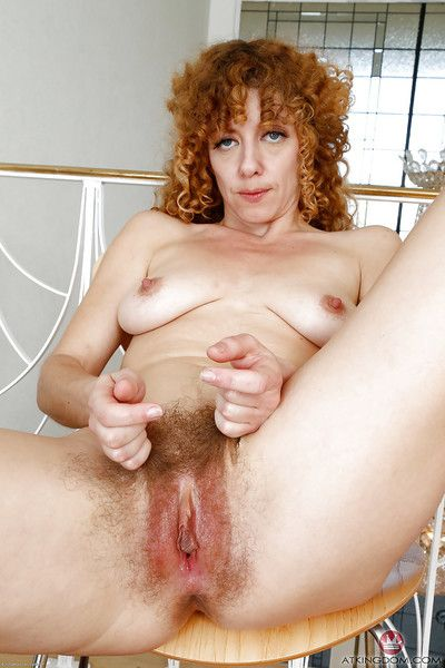 Mature redhead Leona spreading ass cheeks for good look at wide open bush