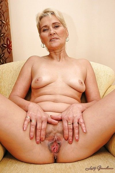 Sexy granny Bibi Taylor taking off her sheer lingerie and exposing her cunt