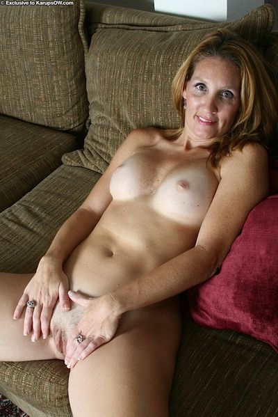 Mature solo girl Lilly freeing big natural boobs from brassiere