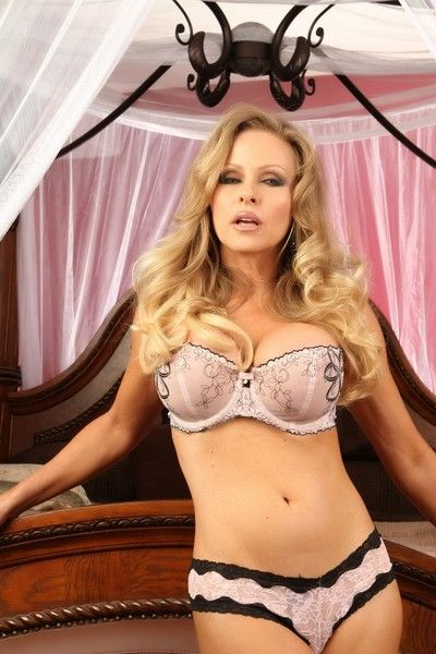 Hot milf Dyanna Lauren with big tits and long legs poses in lingerie and shows her slit