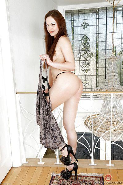 Mature Euro woman Tina Kay baring big natural boobs and ass in high heels