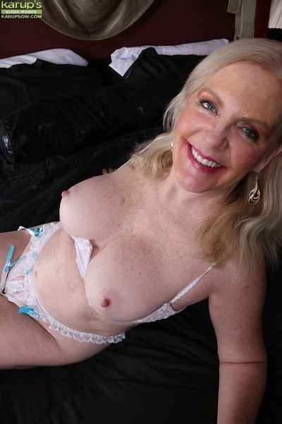 Mature blonde fatty Judy Belkins loosing large boobs and nipples from bra