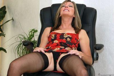 Sexy mature fetish model Satin Jayde spreading her legs in black stockings