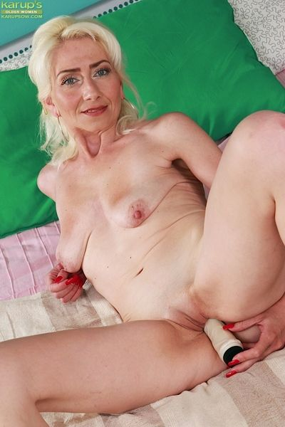 Blonde granny Janotova fingering her shaved mature pussy while masturbating