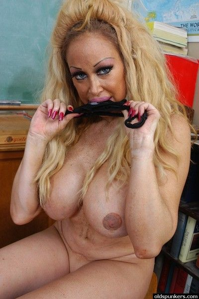 Older teacher Pamela sporting shaved pussy cameltoe in schoolroom