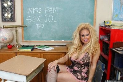 Older teacher Pamela sporting shaved pussy cameltoe in schoolroom