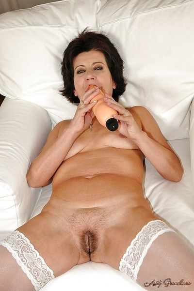 Hot granny with a hairy cunt gets a massive dildo in her pussy