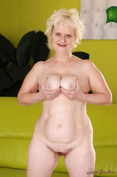 Salacious granny with big flabby tits stripping off her white lingerie