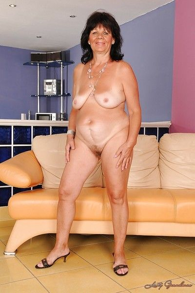 Chubby granny with flabby jugs Helena May stripping and spreading her legs