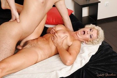 Sexy granny with big tits kissing and fucking a young stiff dick