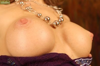 Older lady revealing large boobs and hairy cooter while undressing