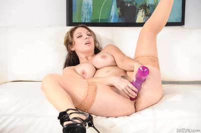 The big titted milf Kiki Daire is ruining her own pussy with the huge sex toy
