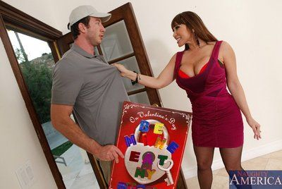 MILF Ava Devine is playing with her big tits and getting ready for some oral sex.