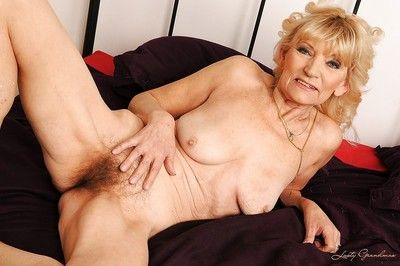 Lusty granny taking off her lingerie and showcasing her shaggy muff