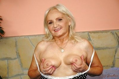 Big titted granny shows her ass upskirt and her wet cunt