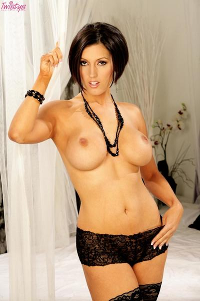 Fine brunette Dylan Ryder poses in beautiful lingerie before spreading her pink pussy