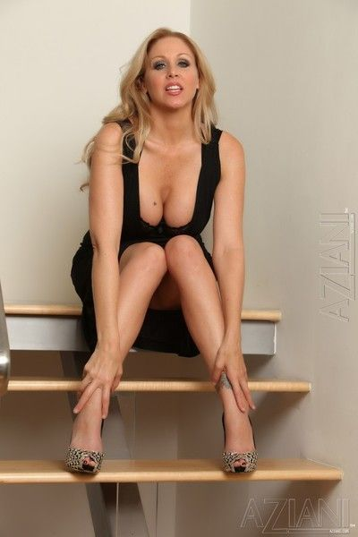 Adorable bosomy milf Julia Ann dressed in black has fun masturbating on the stairs